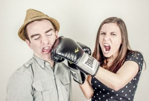Girl boxing a guy for annoying London offices phrases
