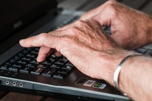 Aged Hands on a Laptop